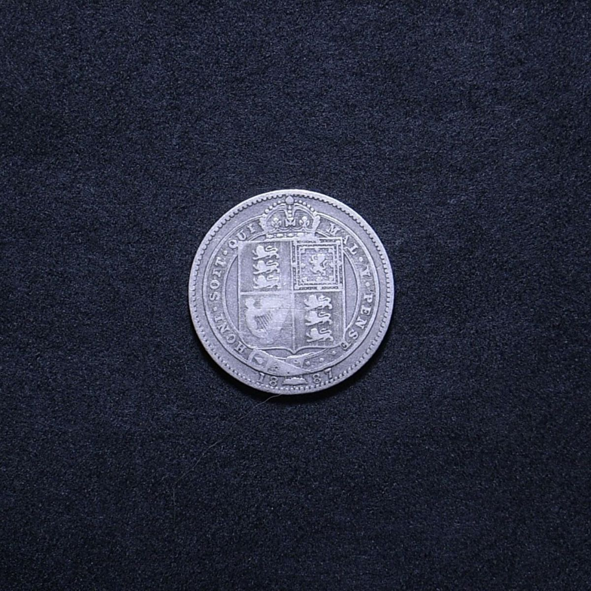 UK 1887 shilling reverse showing the coin's overall appearance