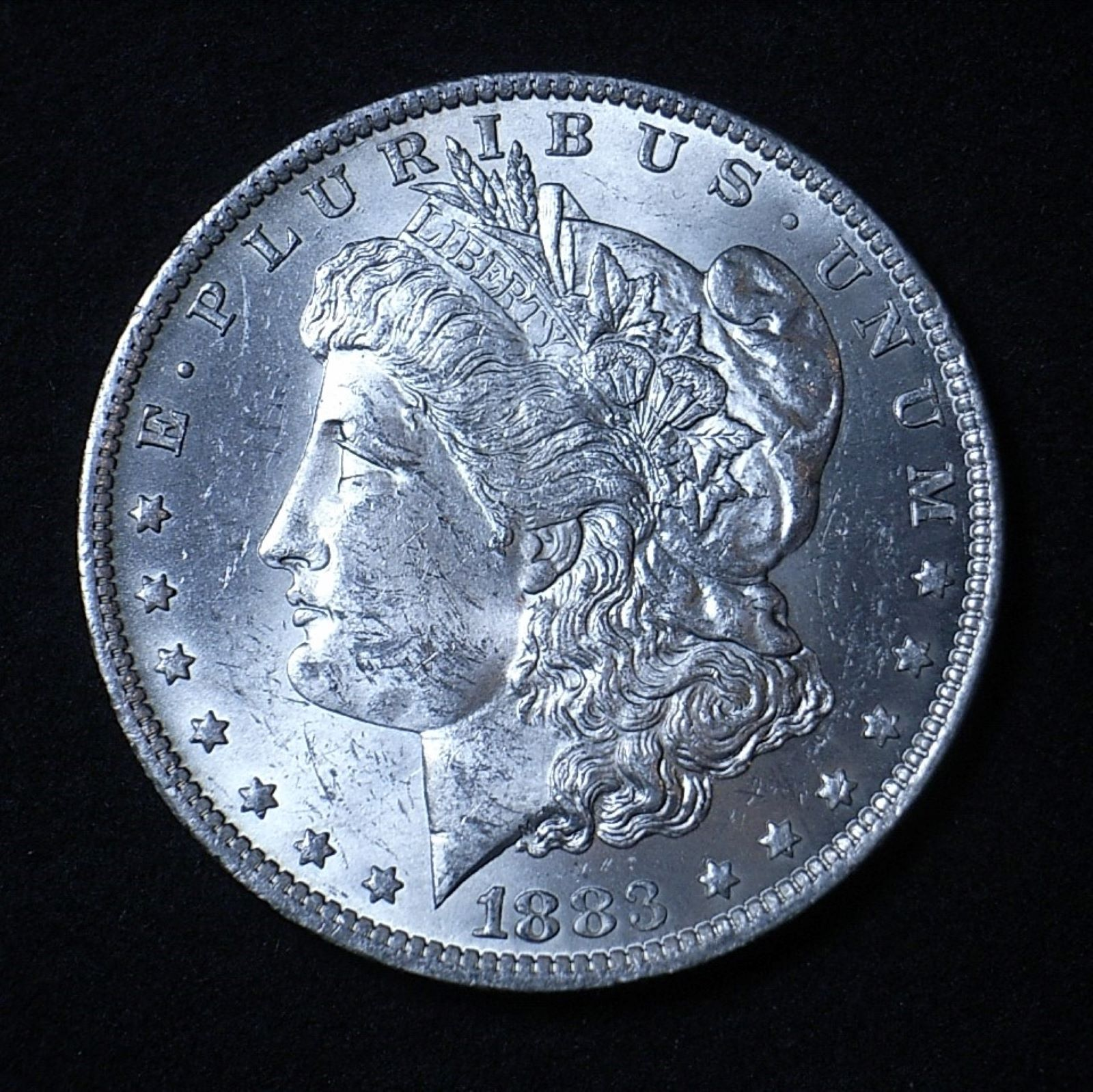 US Morgan Dollar 1883-O obverse close up showing good detail and lustre on the coin
