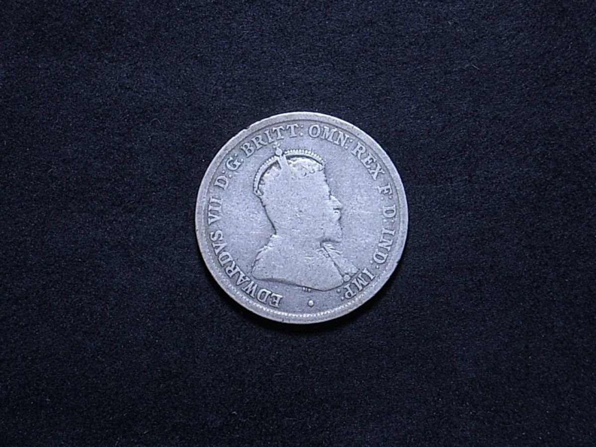 1910 florin obverse showing a lot of wear
