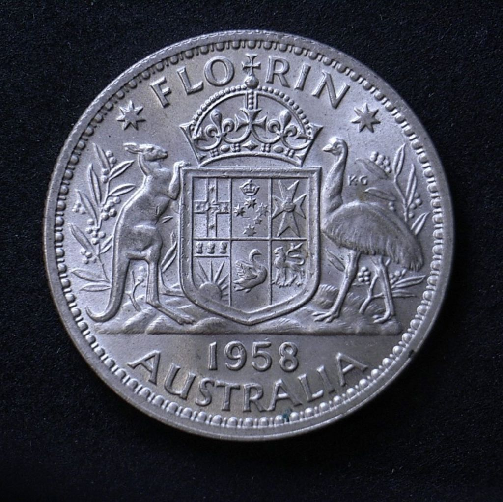 Close up of 1958 florin reverse highlighting the coin's detail