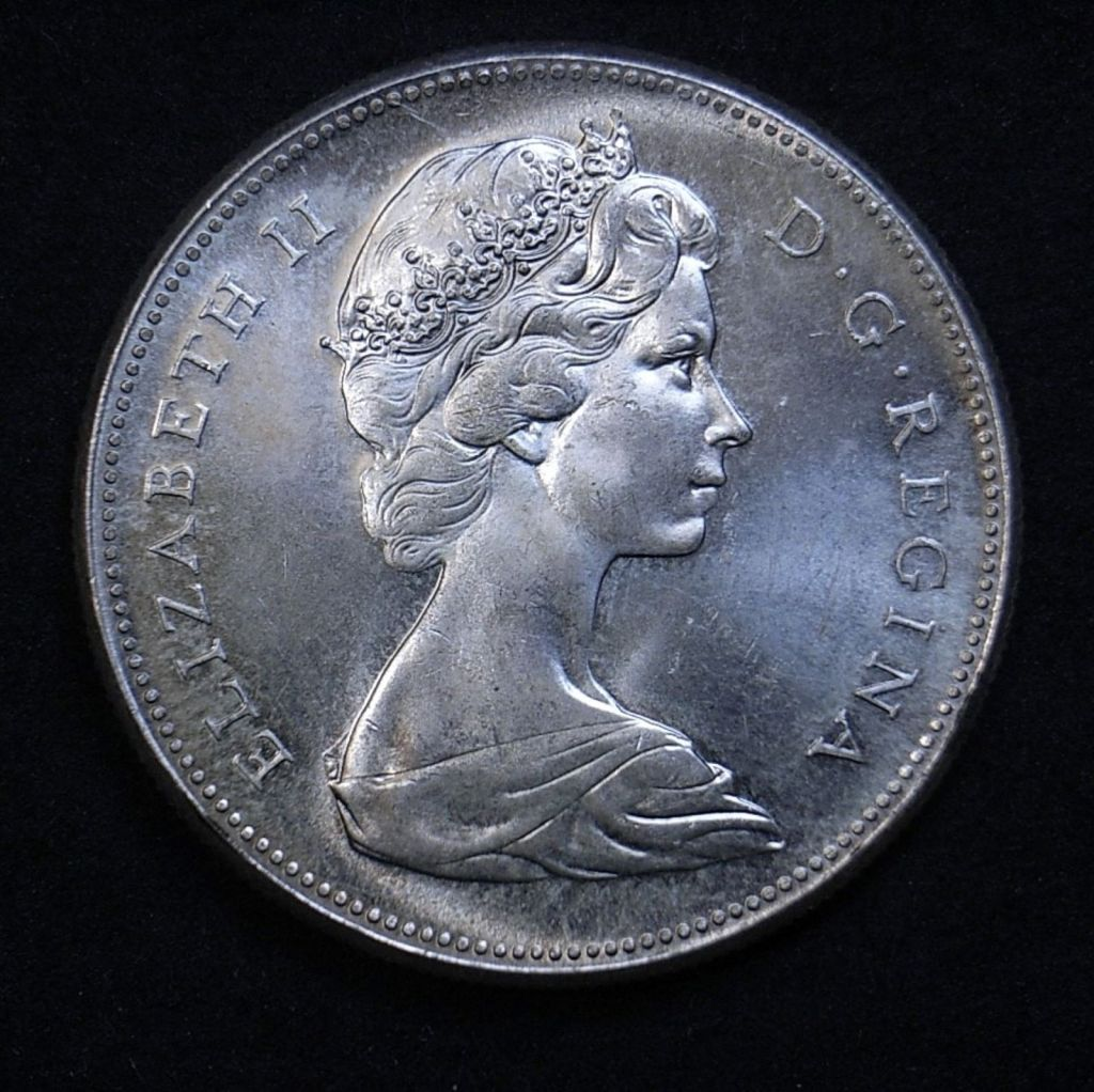 Close up of 1967 Canadian Goose dollar obverse, highlighting the coin's lustre and detail using a different lighting angle