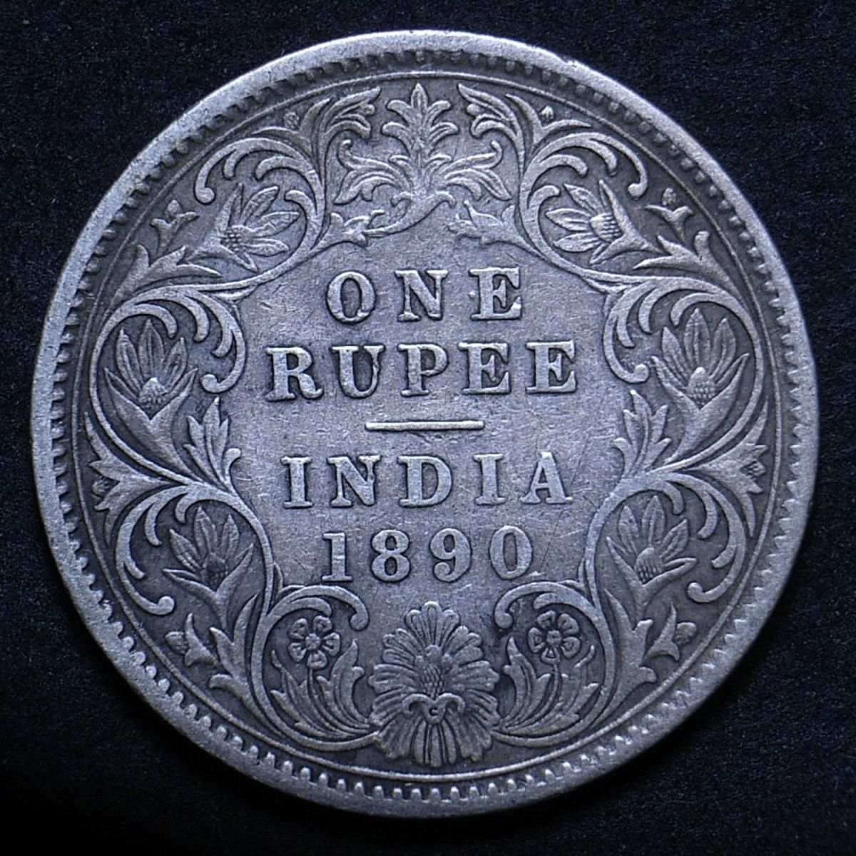 Close up of Indian 1890C rupee reverse showing the coin's detail
