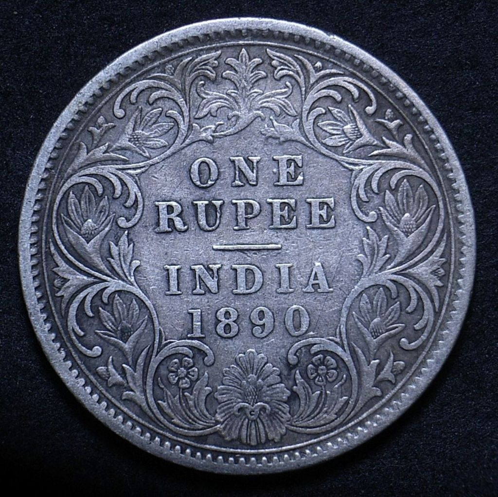 Close up of Indian 1890C rupee reverse showing the coin's detail, different lighting angle
