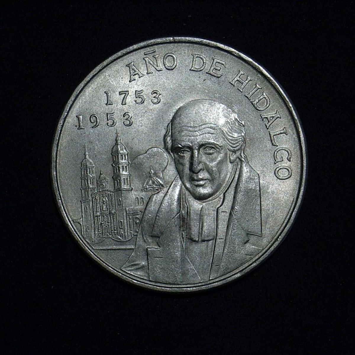 1953 Mexican 5 peso obverse highlighting the coin's lustre
