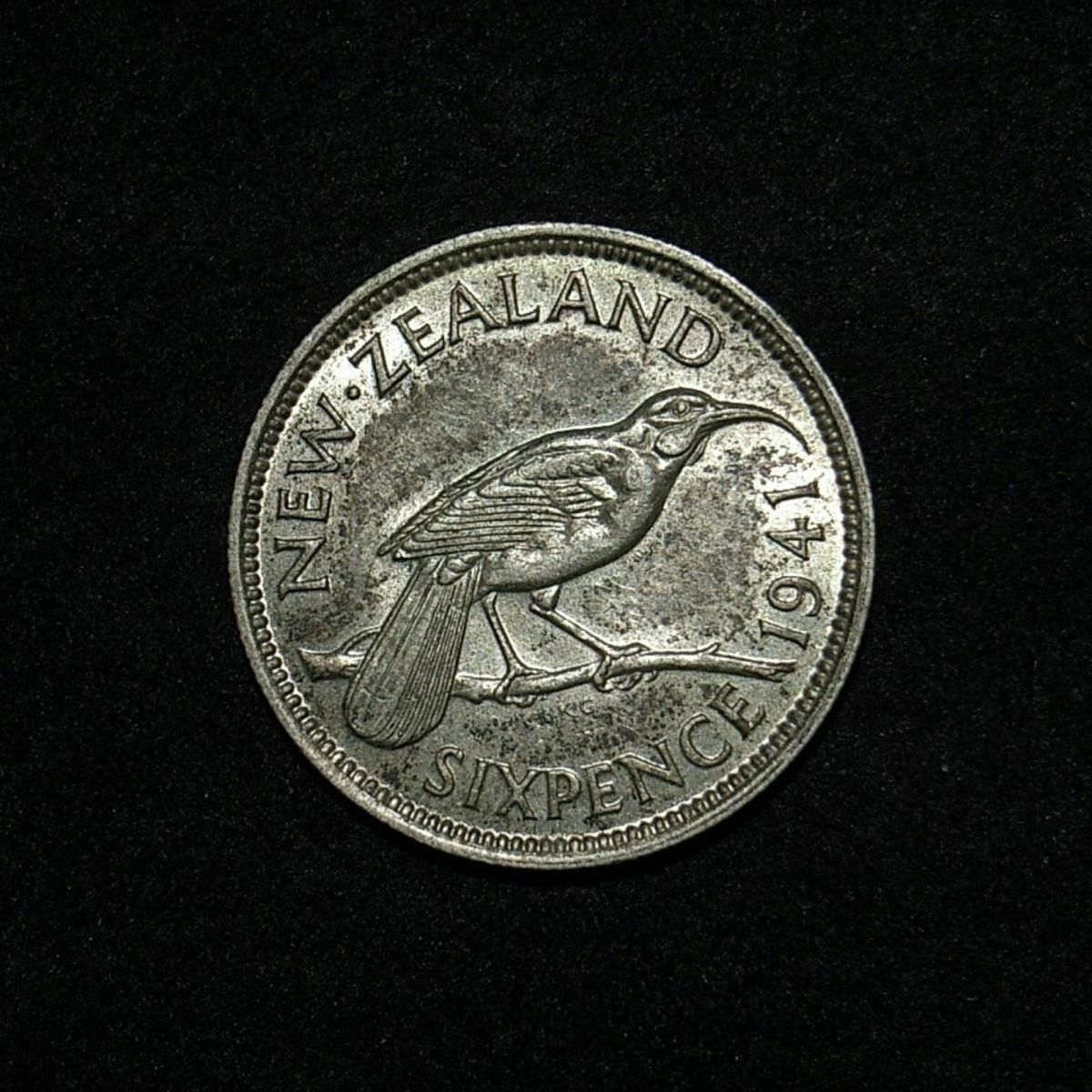 NZ sixpence 1941 reverse close up, new light angle showing detail on the coin