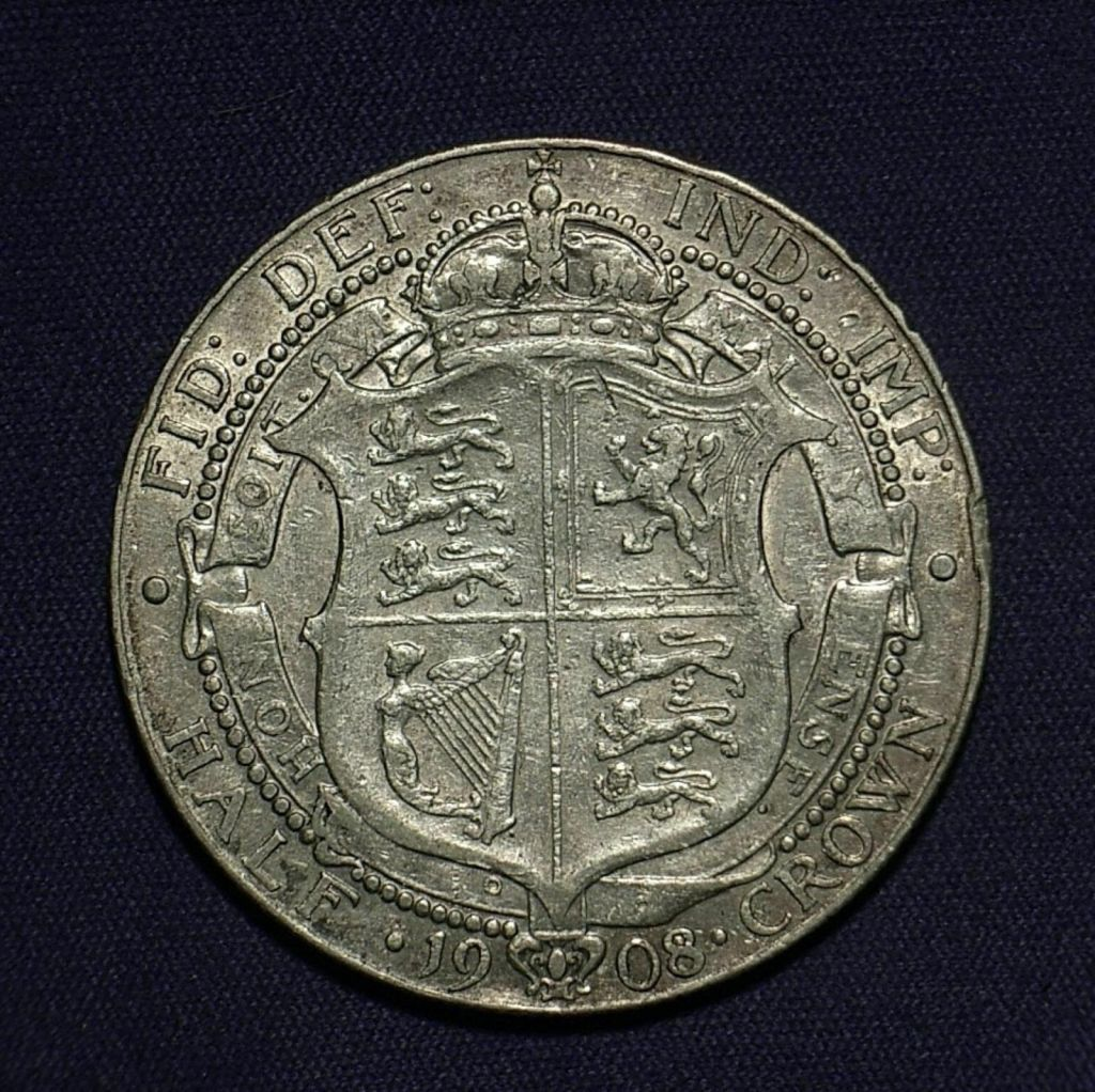 Close up of 1908 UK Half Crown reverse showing the coin's detail, different lighting angle